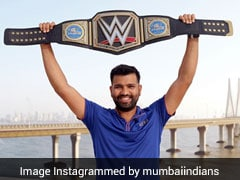 Mumbai Indians Share Picture Of Rohit Sharma With World Heavyweight Champion Belt As The Undertaker Retires