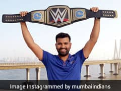 Rohit Poses With World Heavyweight Champion Belt As Undertaker Retires