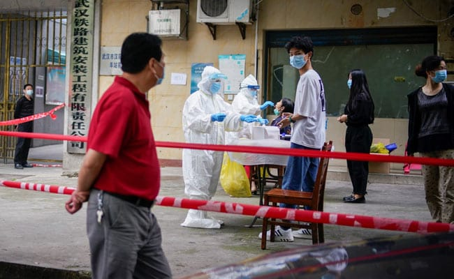 China Questions Coronavirus Origin To Wuhan Ahead Of WHO Probe