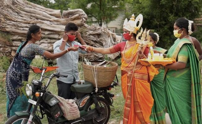 Tamil Nadu Woman Dressed As Goddess Distributes COVID-19 Masks