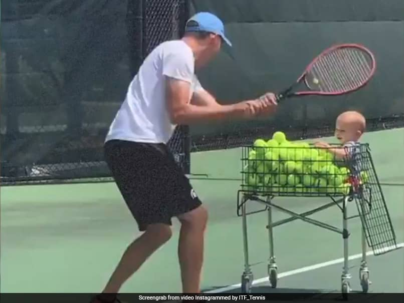 """International Tennis Federation Shares Adorable Video Of """"The Ultimate Tennis Coach"""""""