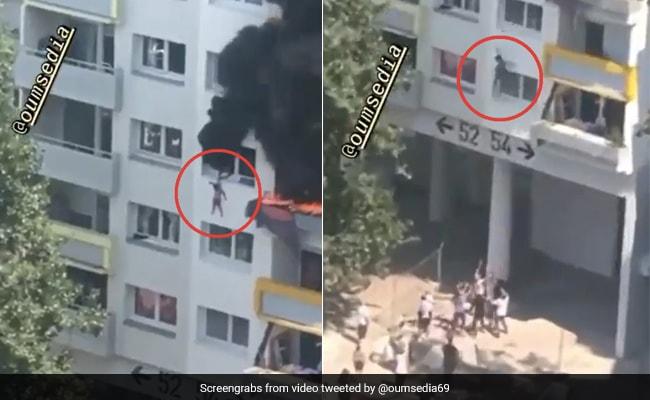 बिल्डिंग में लगी आग तो बच्चे ने लगा दी 40 फीट ऊपर से छलांग, दिल दहला देने वाला Video हुआ वायरल