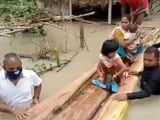 Video : Assam MLA Walks In Waist-High Flood Waters To Rescue People