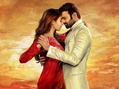 <I>Radhe Shyam</i> First Look: Prabhas And Pooja Hegde Paint The Sky Red