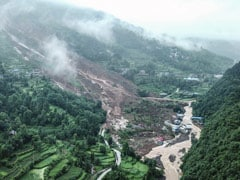 China Landslides Leave At Least 14 Dead Or Missing