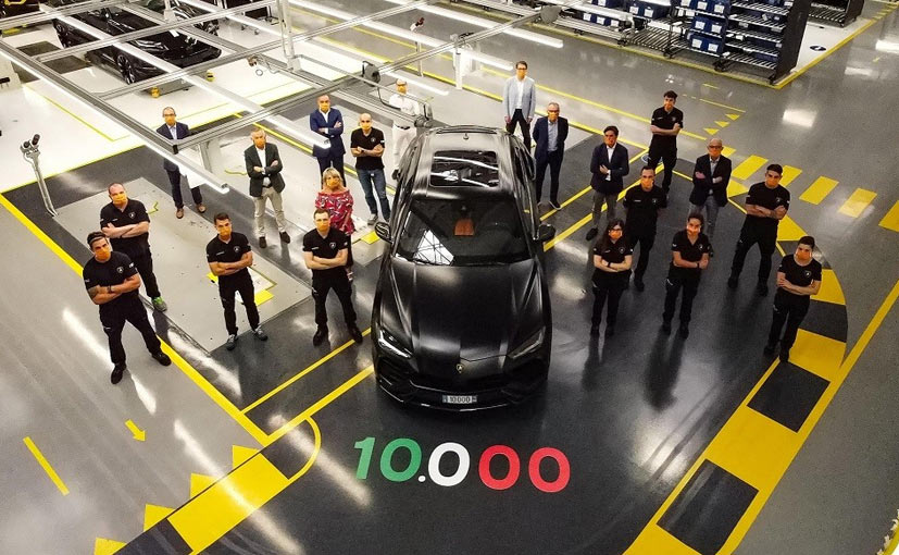 Lamborghini's production team with the 10,000th Urus SUV, which will be shipped to Russia