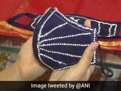 गुजरात की एक ज्वेलरी शॉप दूल्हा-दुल्हन के लिए बेच रही 'हीरों से जड़ा' खास मास्क, कीमत 4 लाख रूपये