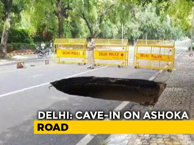 Video : Road In Heart Of Delhi Caves In After Heavy Rain, Flooding In Many Areas
