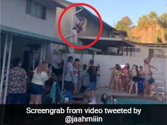On Camera, Woman's Attempt To Jump Into Pool From Roof Goes Horribly Wrong