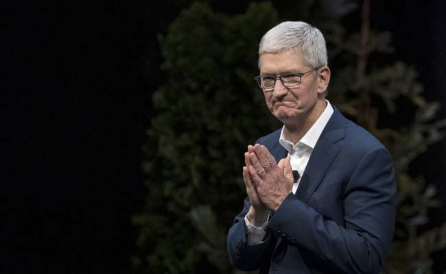 Tim Cook Joins Billionaire Club As Apple's Value Nears  Trillion