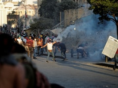 Beirut Police Fire Tear Gas At Protesters Pelting Stones Near Parliament