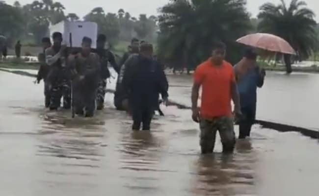 Watch: CRPF Personnel Carry Soldier's Dead Body On Foot Amid Rising Water