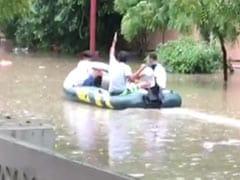 Boat On Waterlogged Road, Submerged Underpasses: Rain Paralyses Gurgaon