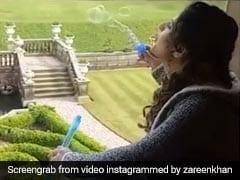 Zareen Khan खिड़की पर बैठकर बना रही थीं बुलबुले, सोशल मीडिया पर वायरल हो रहा है Video
