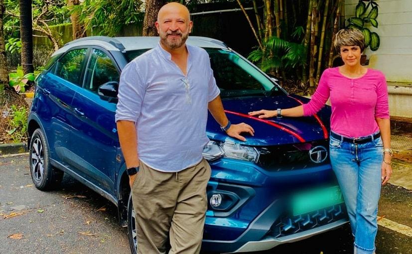 Mandira Bedi with her husband and their new Tata Nexon EV
