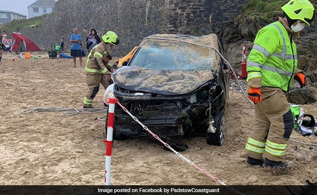 Out-Of-Control Car Plunges Down 20-Foot Cliff, Lands On Busy Beach