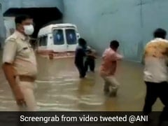 Watch: Locals Pull Out Ambulance Stuck In Waterlogged Underpass In Gujarat