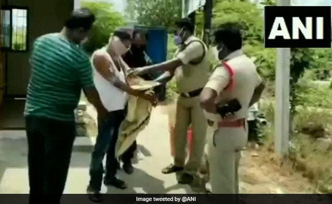Man Arrested With 47 Liquor Bottles Stuck To His Body With Tape In Andhra