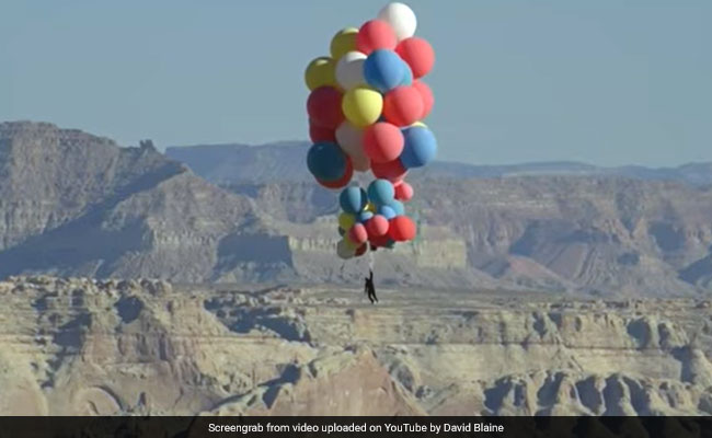 Daredevil David Blaine Flies Into The Sky With 52 Helium Balloons. Watch