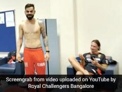 IPL 2020: RCB ने जीत पर ड्रेसिंग रूम में मचाया धमाल, कोहली ने टी-शर्ट उतार यूं मनाया जश्न- देखें Video