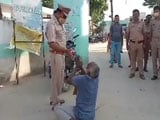 Video : Please Don't Shoot Me: Wanted Criminal With Placard Surrenders To UP Police