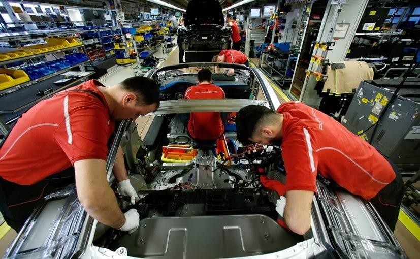Employees of German car manufacturer Porsche at its factory in Stuttgart-Zuffenhausen
