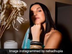 In A One-Shoulder Dress, Neha Dhupia Aces The Work From Home Look