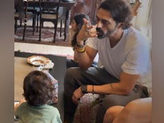 A Scene From Arjun Rampal And Gabriella Demetriades' Living Room, With Arik, Mahikaa And Myra