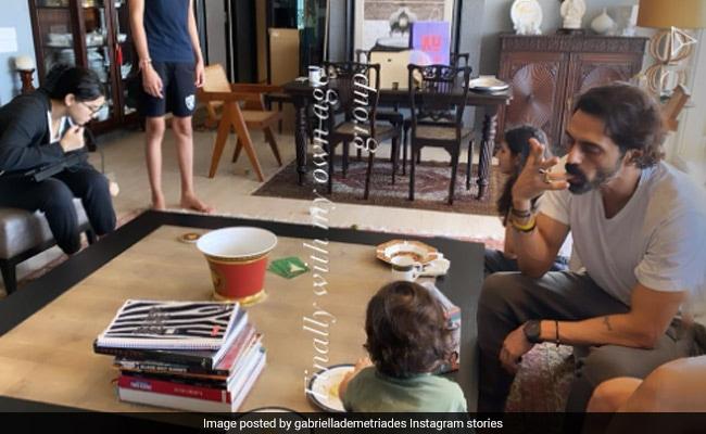 A Scene From Arjun Rampal And Gabriella Demetriades' Living Room, With Arik, Mahikaa And Myra