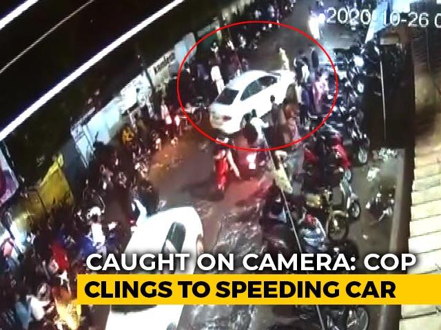 Video : Caught On Camera: Cop Clings To Speeding Car's Bonnet In Madhya Pradesh