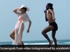 नोरा फतेही ने Beach पर दोस्त के साथ व्हाइट ड्रेस में किया डांस, Video में दिखा जबरदस्त अंदाज