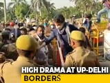 Video : Watch: Priyanka Gandhi Vadra Shields Congress Workers During Lathi Charge