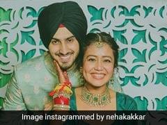 नेहा कक्कड़ ने पहना लाल चूड़ा और मेहंदी में लिखा रोहनप्रीत सिंह का नाम, खूब Viral हो रही हैं Photos