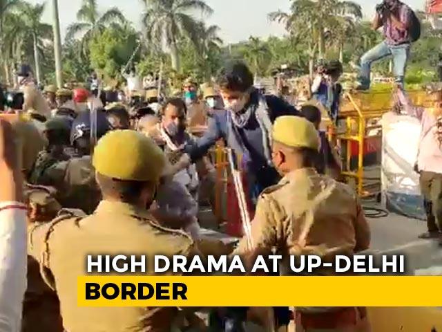 Video : Watch: Priyanka Gandhi Vadra Shields Congress Workers During Lathi Charge