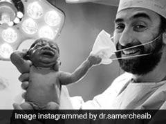 पैदा होने के तुरंत बाद बच्चे ने डॉक्टर के चेहरे से हटाया मास्क, Photo ने सोशल मीडिया पर मचाया तहलका