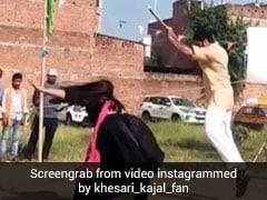 Bhojpuri: खेसारी लाल यादव पर लाठी लेकर टूट पड़ीं काजल राघवानी, Video हुआ वायरल