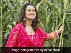 Neha Kakkar गुलाबी सूट पहन खेतों में आईं नजर, बोलीं- आजा चल व्याह करवाइये- देखें Photos