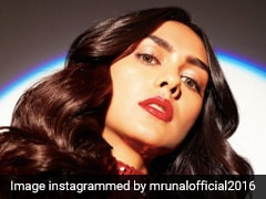 Mrunal Thakur Sparkles With Red Lipstick, Neutral Eye Makeup And A Curly Hairstyle