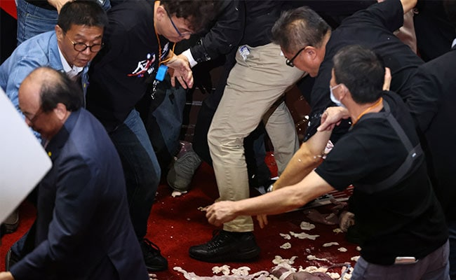 Pig Guts Fly In Taiwan Parliament In Dispute Over US Pork Imports