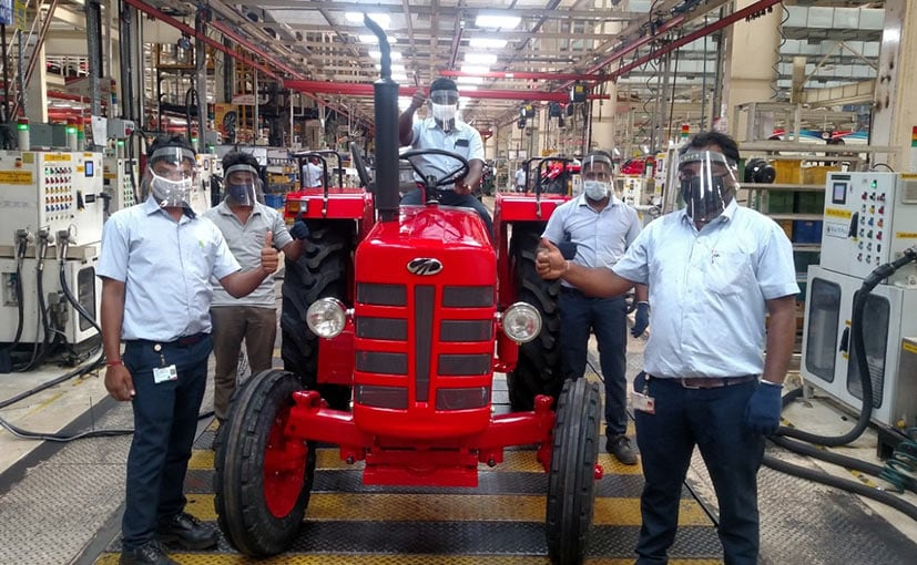 Mahindra's Zaheerabad plant employees with an E7 series tractor