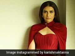 Karishma Tanna Owns Her Magic In A Striking Red Cape Gown