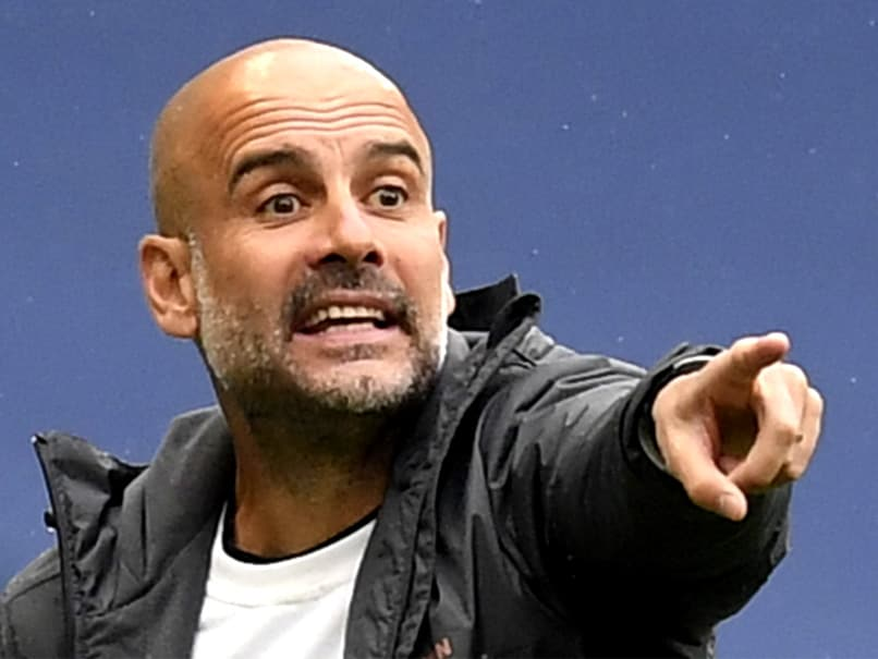 Pep Guardiola extends Man City deal until 2023
