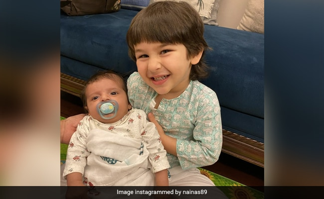 The Internet Can't Stop Gushing Over This Adorable Pic Of Taimur Holding A Baby
