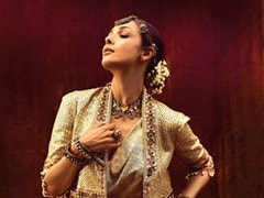 Malaika Arora Sparkles In An Ethnic Fusion Look With A Gold Jacket And Chunky Jewellery