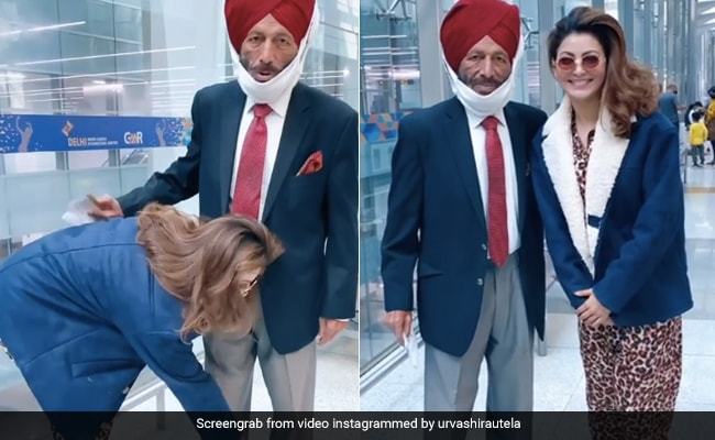 उर्वशी रौतेला ने एयरपोर्ट पर मिल्खा सिंह को देख छू लिये उनके पैर, फिर यूं साथ क्लिक कराई फोटो- Viral हुआ Video