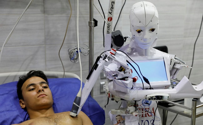 Now A Remote-Controlled Robot To Test Covid, Warn Those Without Mask