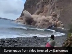 Shocking Video Shows A Huge Chunk Of Cliff Collapsing Near Beachgoers