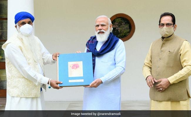 PM Modi Releases Book On Life And Ideals Of Guru Nanak Dev
