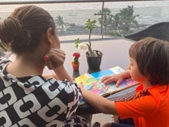 """All Grown Up"": Gauri Khan Shares A Pic Of Little AbRam Reading Karan Johar's New Book"
