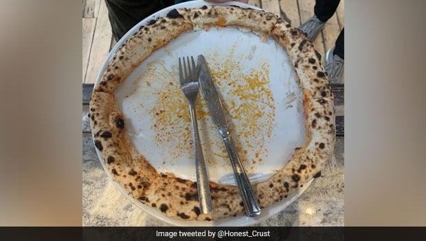 Pizza Gone Wrong? Viral Pic Has Netizens Divided Over The Right Way To Eat It